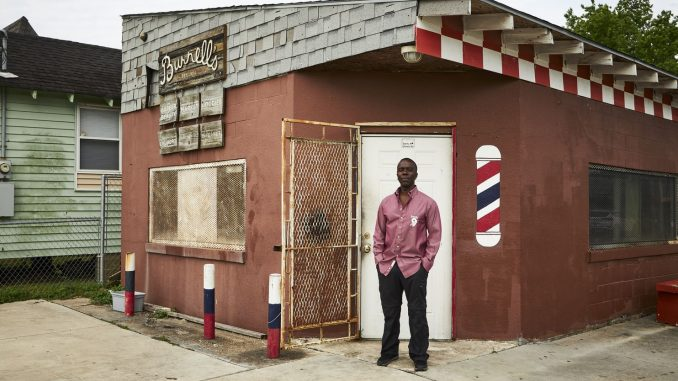 Burnell Cotlon in front of his store